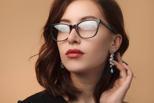 beautiful woman in black rimmed spectacles - lens eye stock pictures, royalty-free photos & images