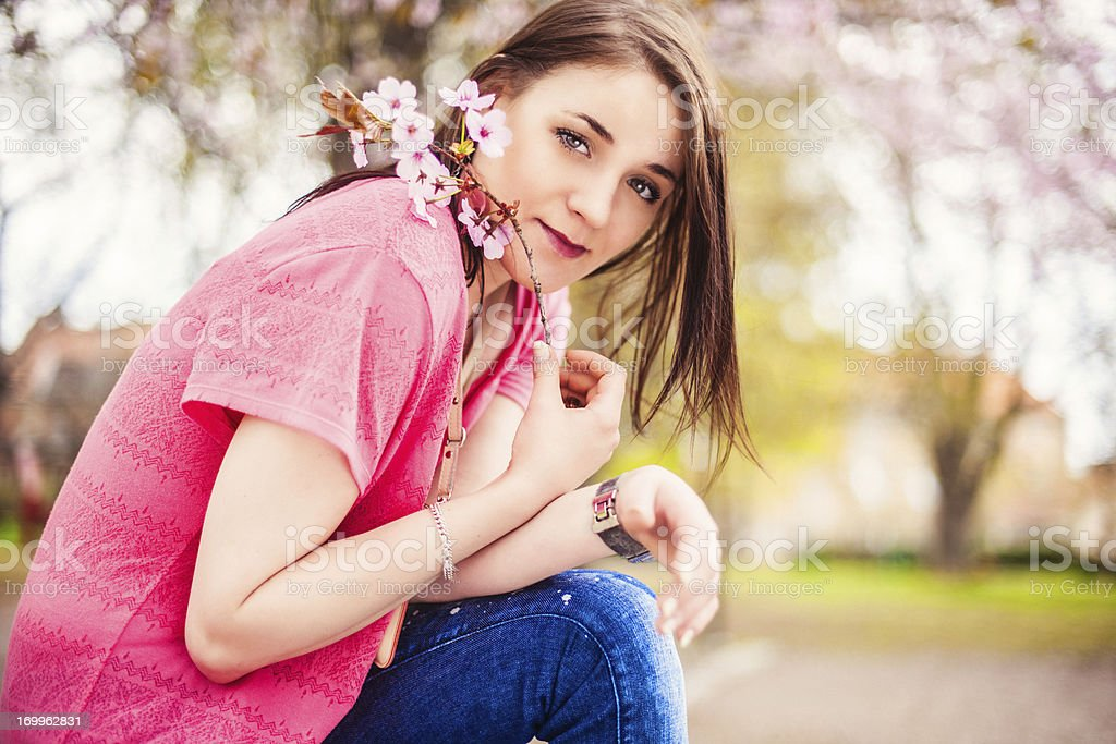 Beautiful woman in blooming nature royalty-free stock photo