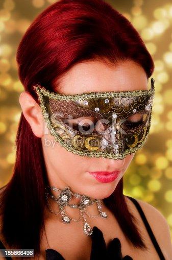 istock Beautiful woman in carnival mask. 185866496