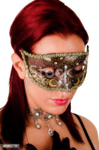 istock Beautiful woman in carnival mask 465607781
