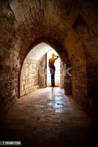 Beautiful woman in castle corridor