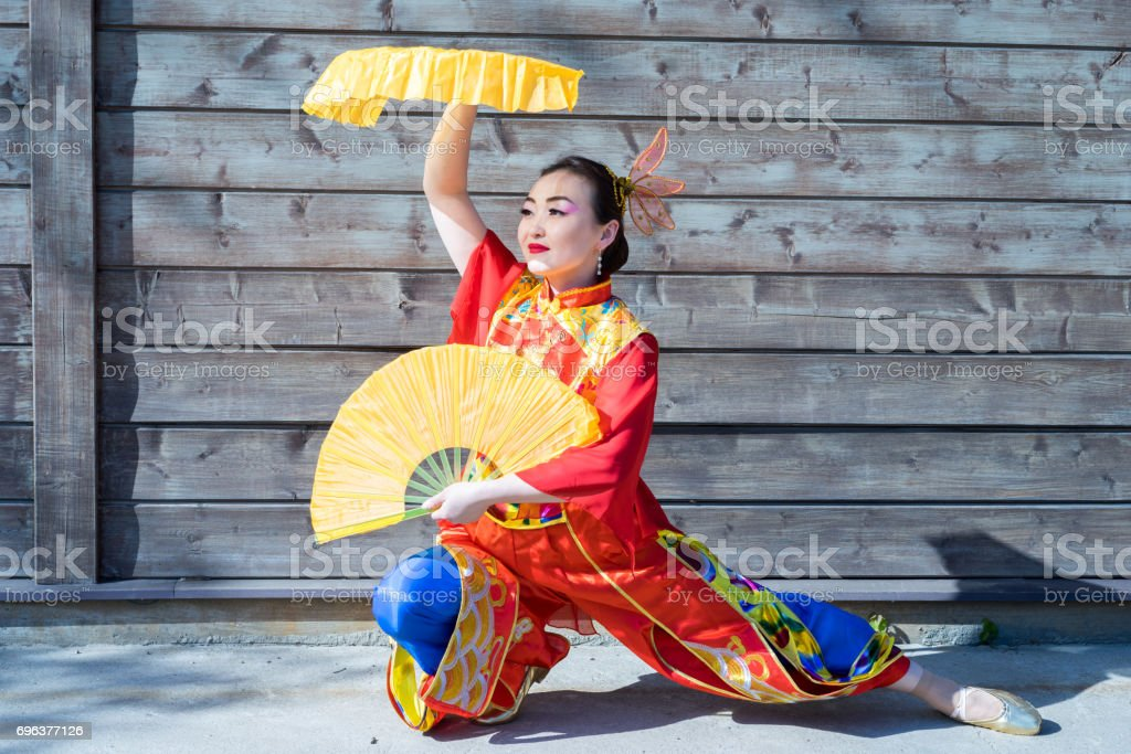 Beautiful Woman In Chinese Traditional Costume With Two Big Yellow