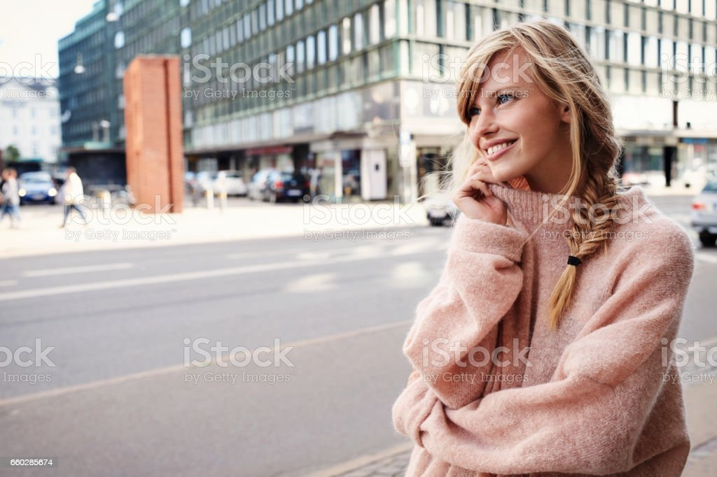Beautiful woman in city stock photo