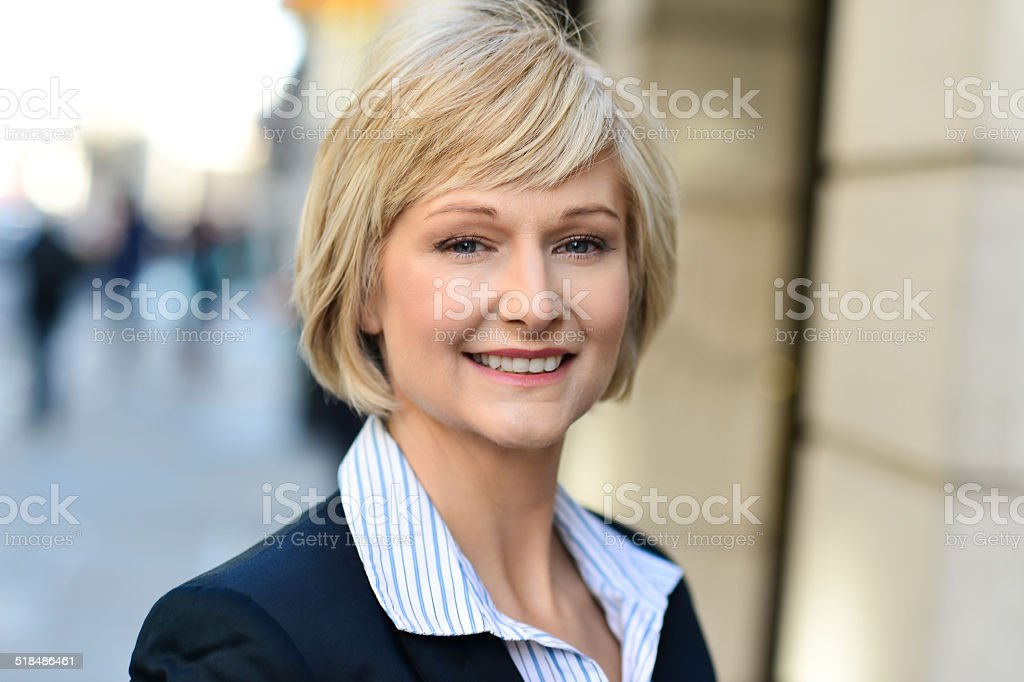 Beautiful woman in city street royalty-free stock photo