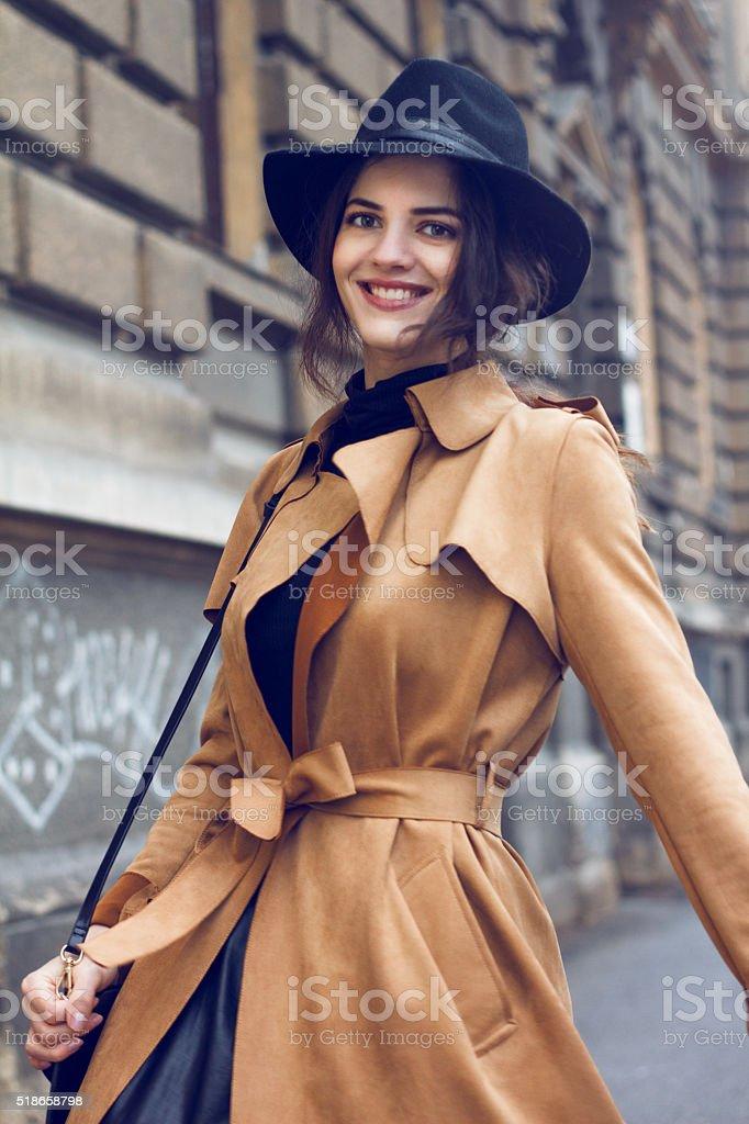 Beautiful woman in coat stock photo