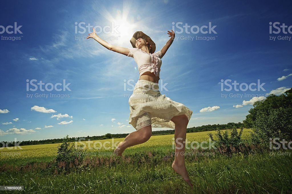 Beautiful woman in cowboy hat jumping. royalty-free stock photo