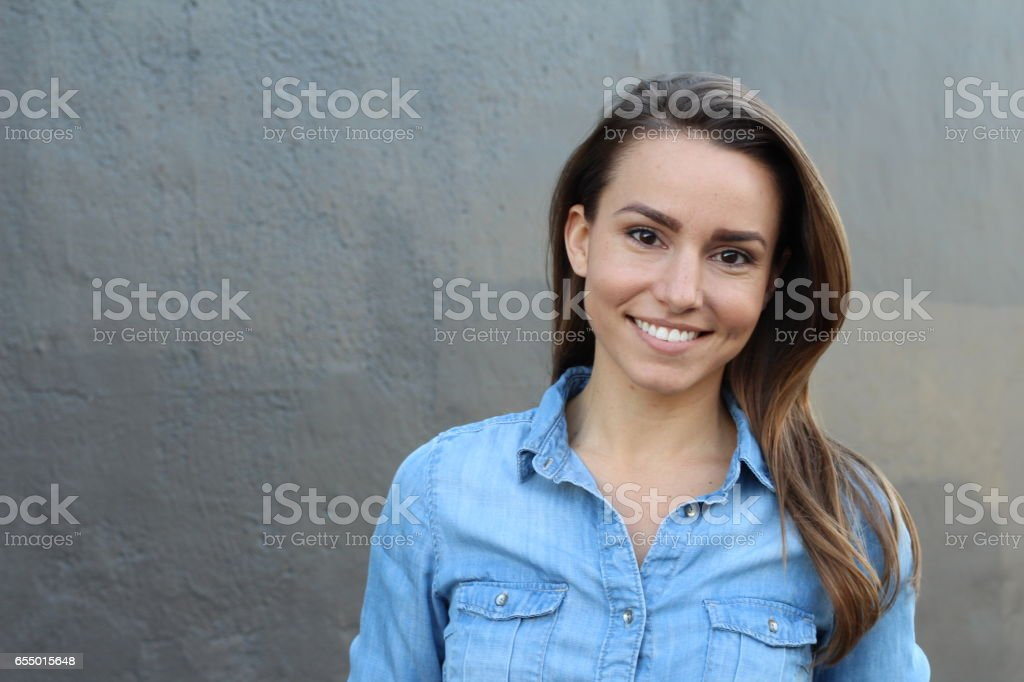 Beautiful woman in denim shirt smiling stock photo