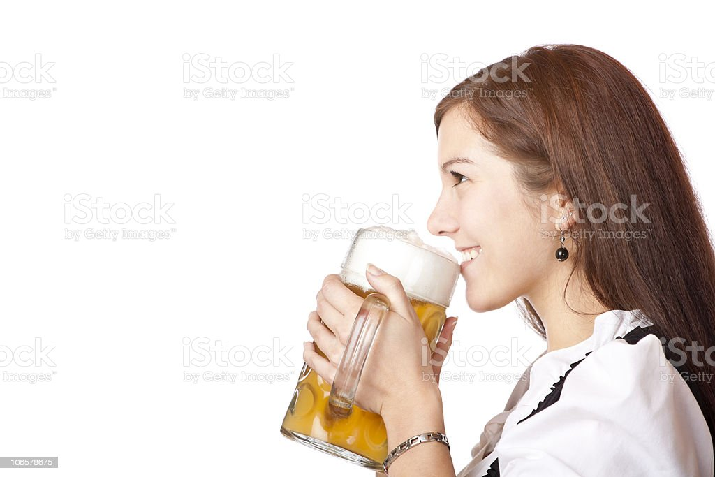 Beautiful woman in dirndl dress holds Oktoberfest beer stein royalty-free stock photo