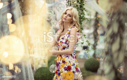 istock Beautiful woman in dress of flowers 484888010