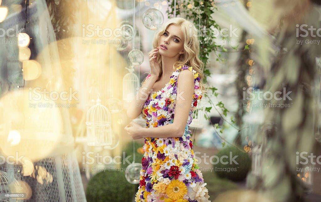 Beautiful woman in dress of flowers stock photo
