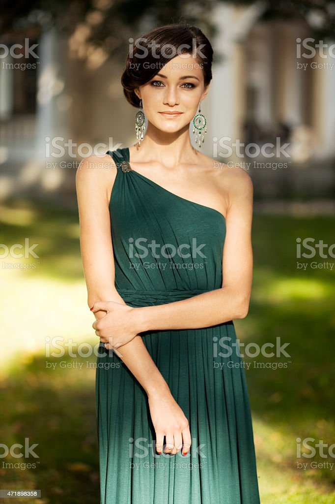 Beautiful woman in evening dress stock photo