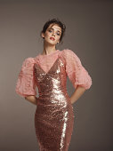 istock Beautiful woman in fashionable dress 1197837256