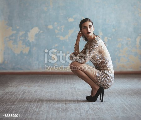 Portrait of fashionable woman in sequin dress. Professional make-up and hairstyle.