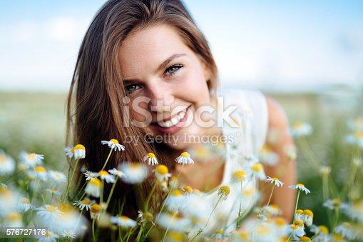 istock Beautiful woman in field 576727176