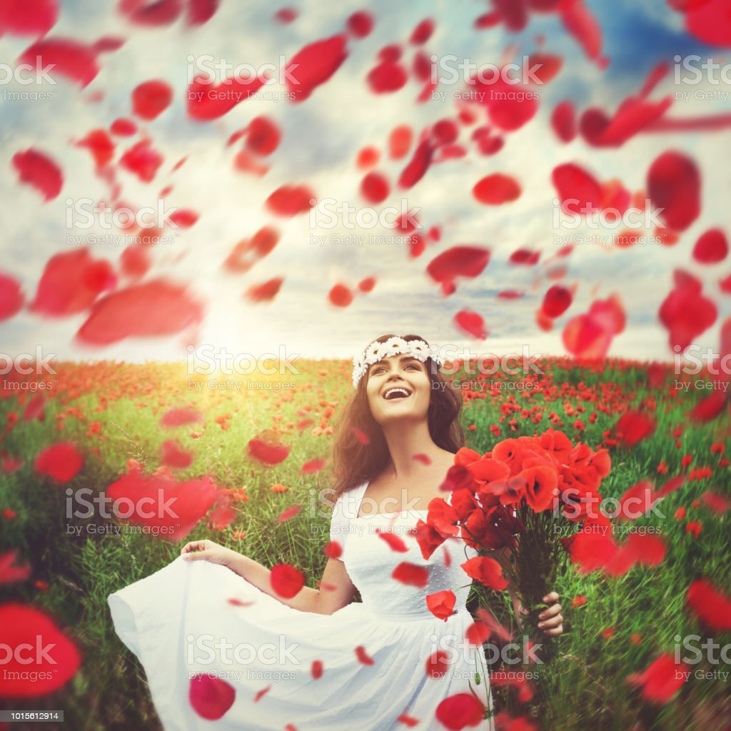 Beautiful Woman In Field With A Lot Of Poppy Flowers Stock Photo