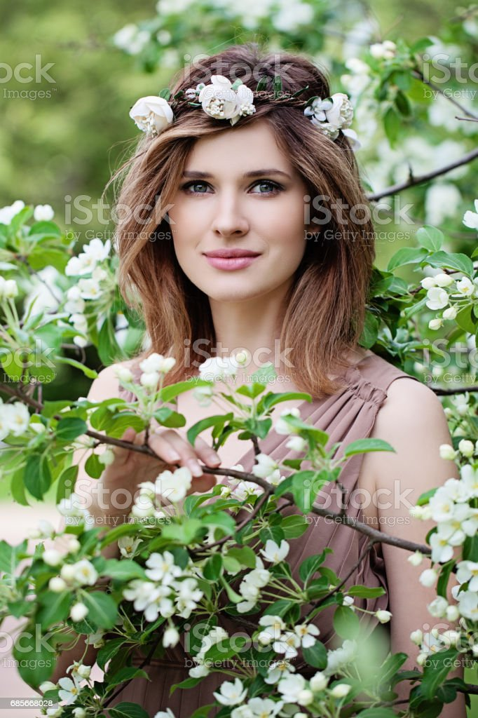 Beautiful Woman in Flowers Wreath. Long Bob Hairstyle, Makeup and Flowers royalty-free stock photo