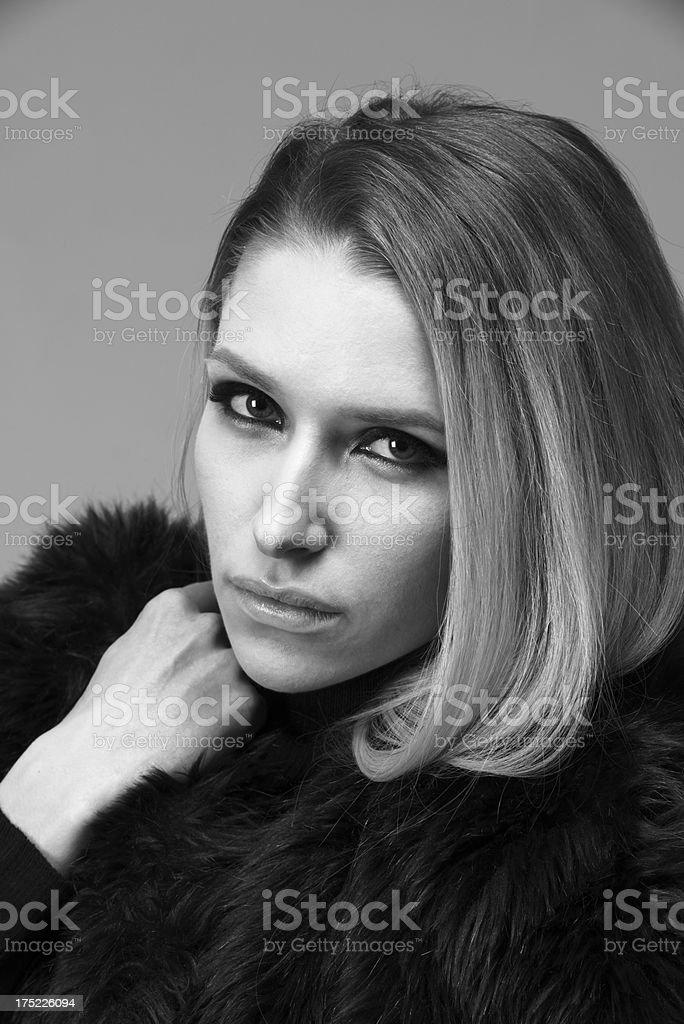 Beautiful woman in fur coat royalty-free stock photo