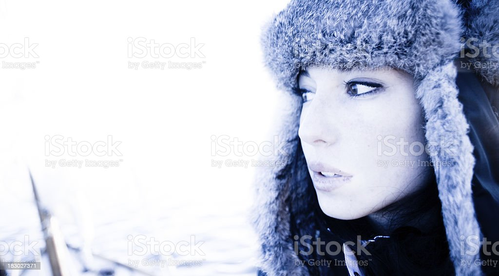 Beautiful woman in fur hat on the prow of boat royalty-free stock photo