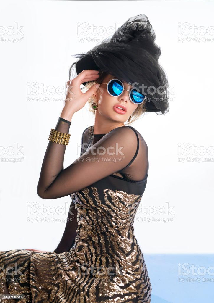 Beautiful woman in glistening dress and hat royalty-free stock photo