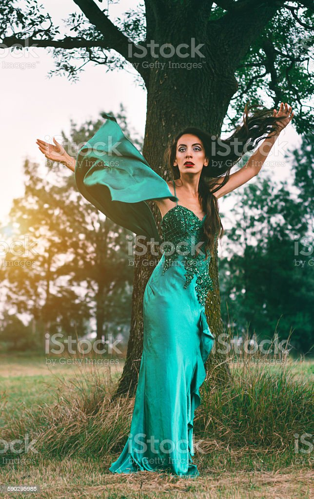 beautiful woman in green dress in the nature royaltyfri bildbanksbilder