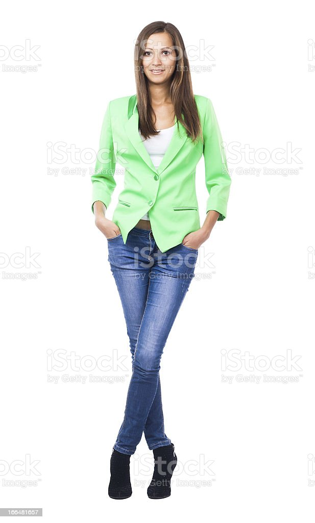 Beautiful woman in green jacket and blue denims royalty-free stock photo