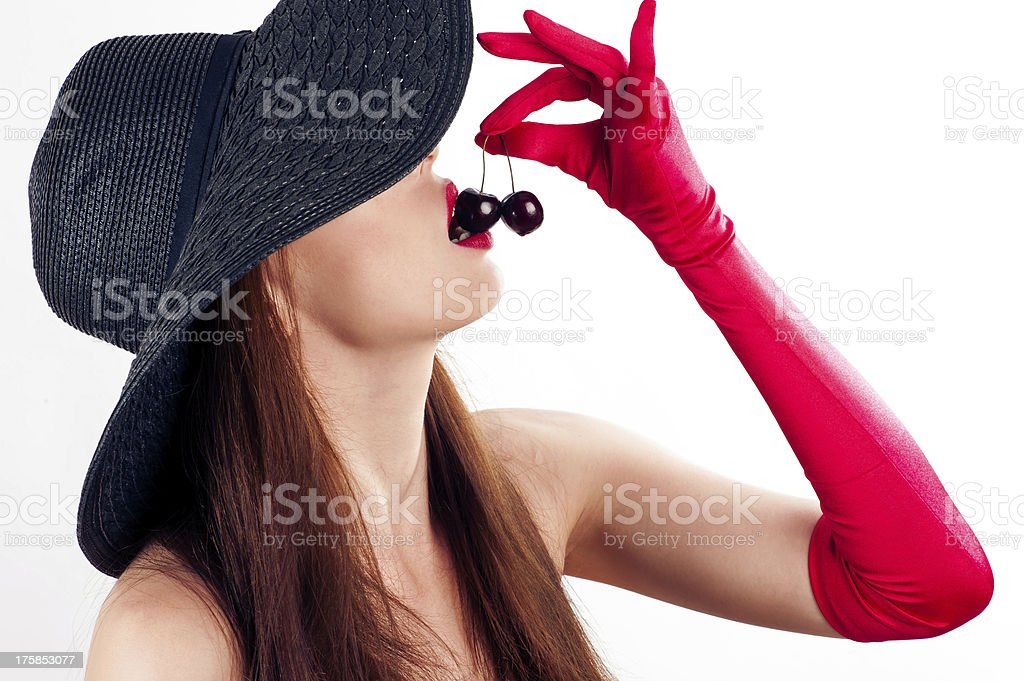 beautiful woman in hat and gloves stock photo