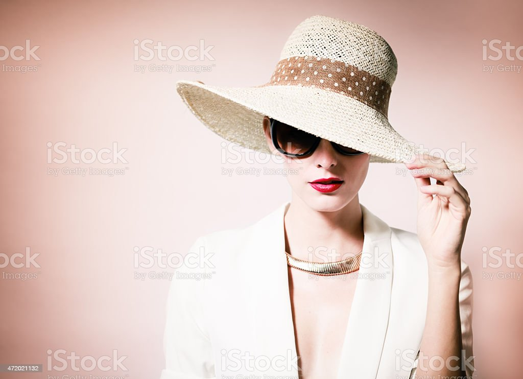 Beautiful woman in hat stock photo