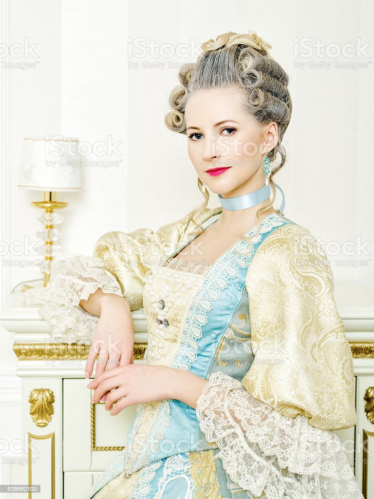 Beautiful woman in historical dress in Baroque style stock photo