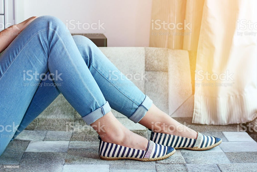 beautiful woman in jeans and shoes stock photo