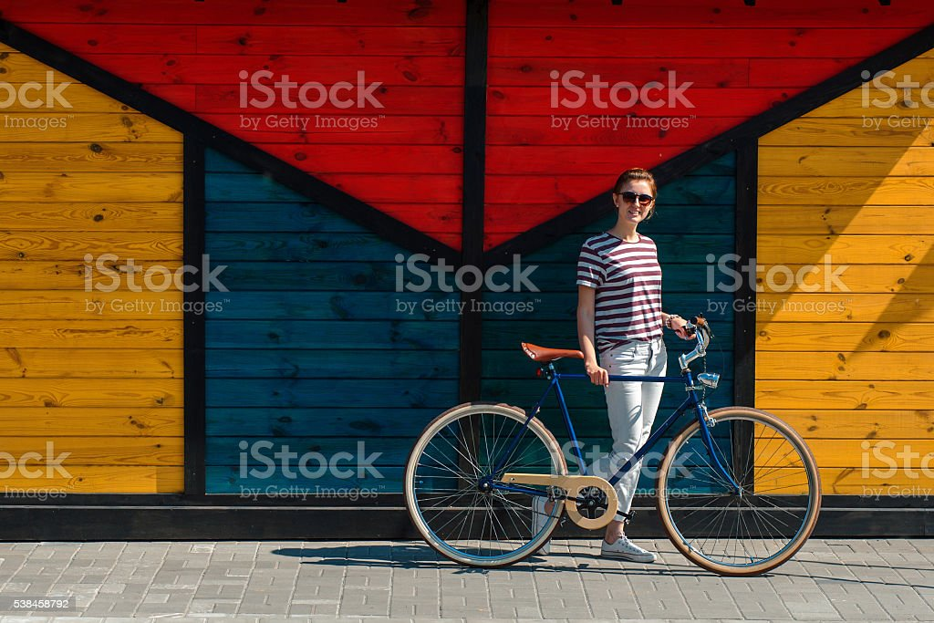 beautiful woman in jeans with bike stock photo