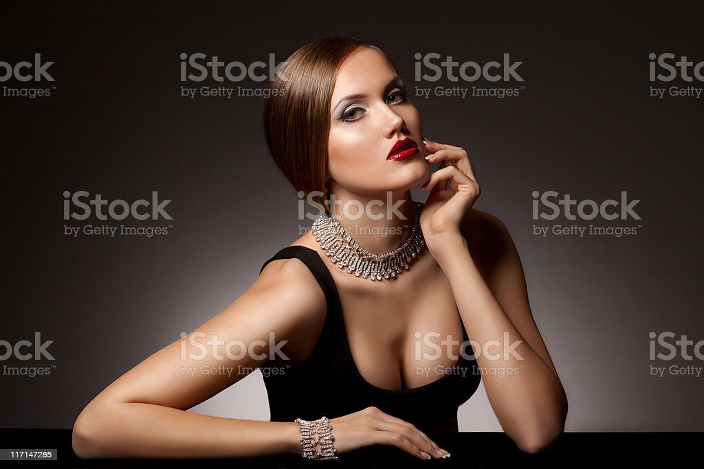 Beautiful woman in jewelry royalty-free stock photo