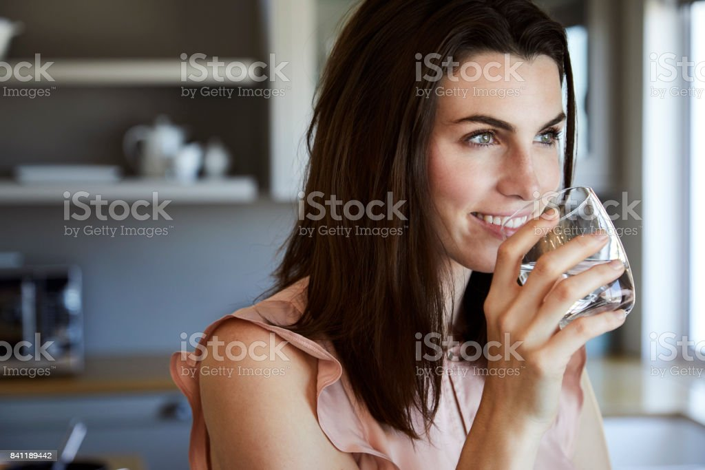 Beautiful woman in kitchen stock photo
