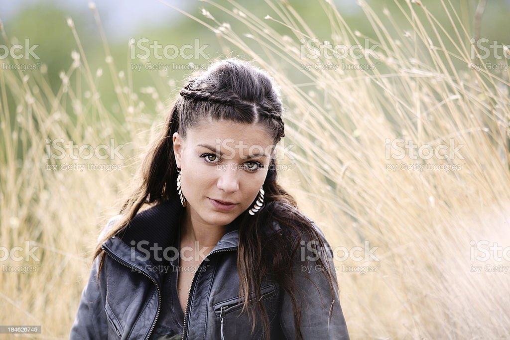 Beautiful Woman in Leather Jacket Outdoors Horizontal stock photo