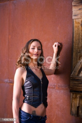 istock Beautiful woman in leather vest 145929008