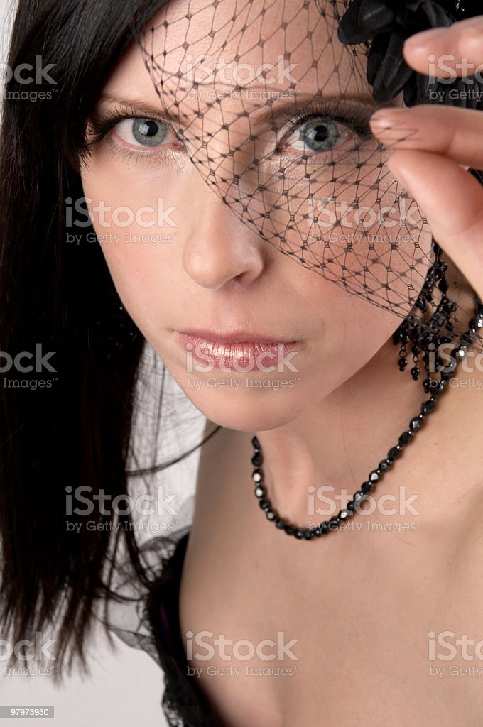 Beautiful woman in lingerie peaks through veil. royalty-free stock photo