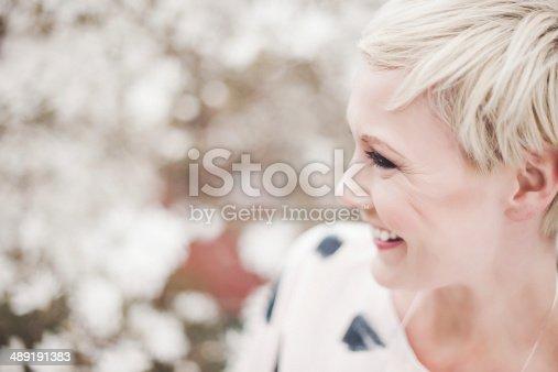 istock Beautiful woman in magnolia 489191383