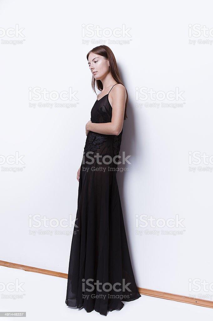 Beautiful woman in maxi dress stock photo