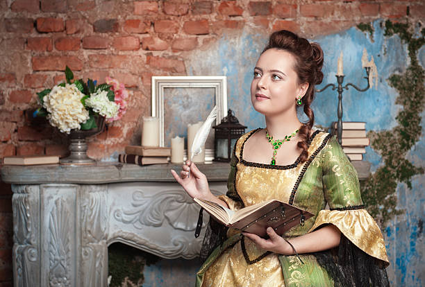 beautiful woman in medieval dress writing - petticoat stock pictures, royalty-free photos & images