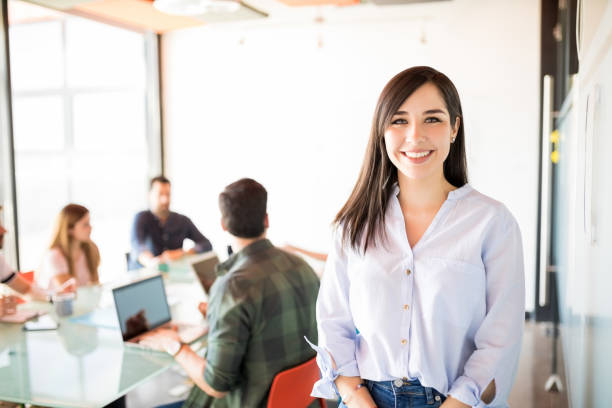 Beautiful woman in meeting room Young businesswoman in casual clothes at modern startup meeting room apprentice stock pictures, royalty-free photos & images