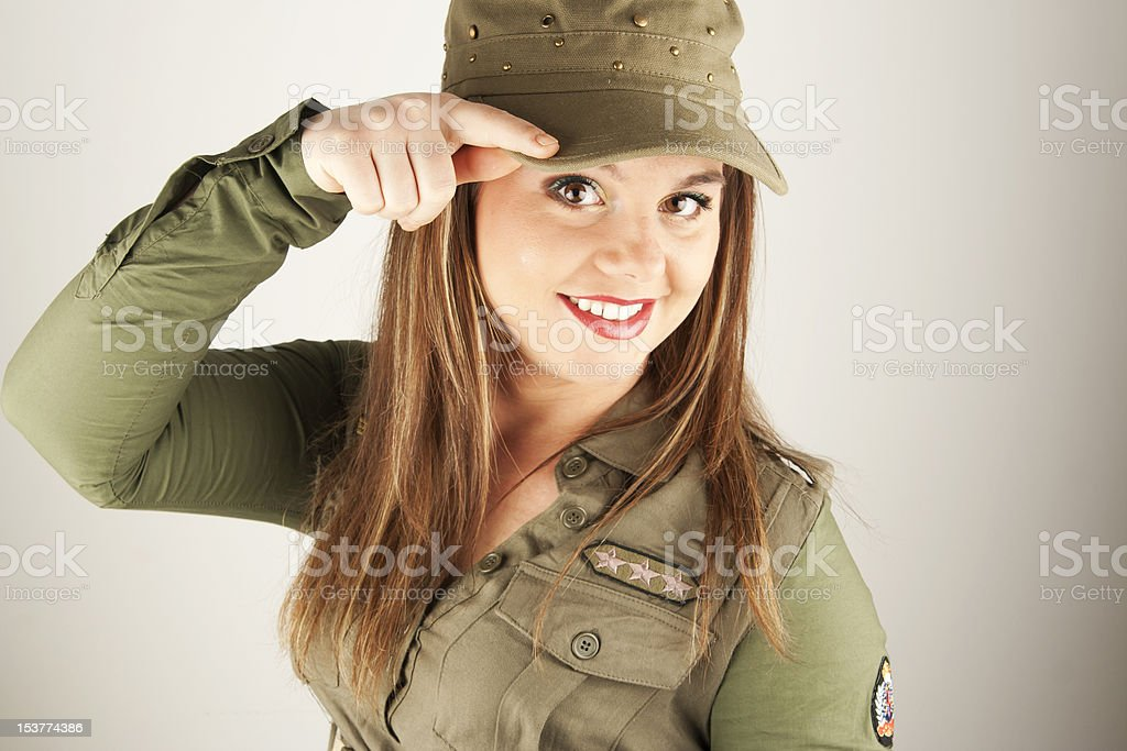 Beautiful woman in military clothes saluting royalty-free stock photo