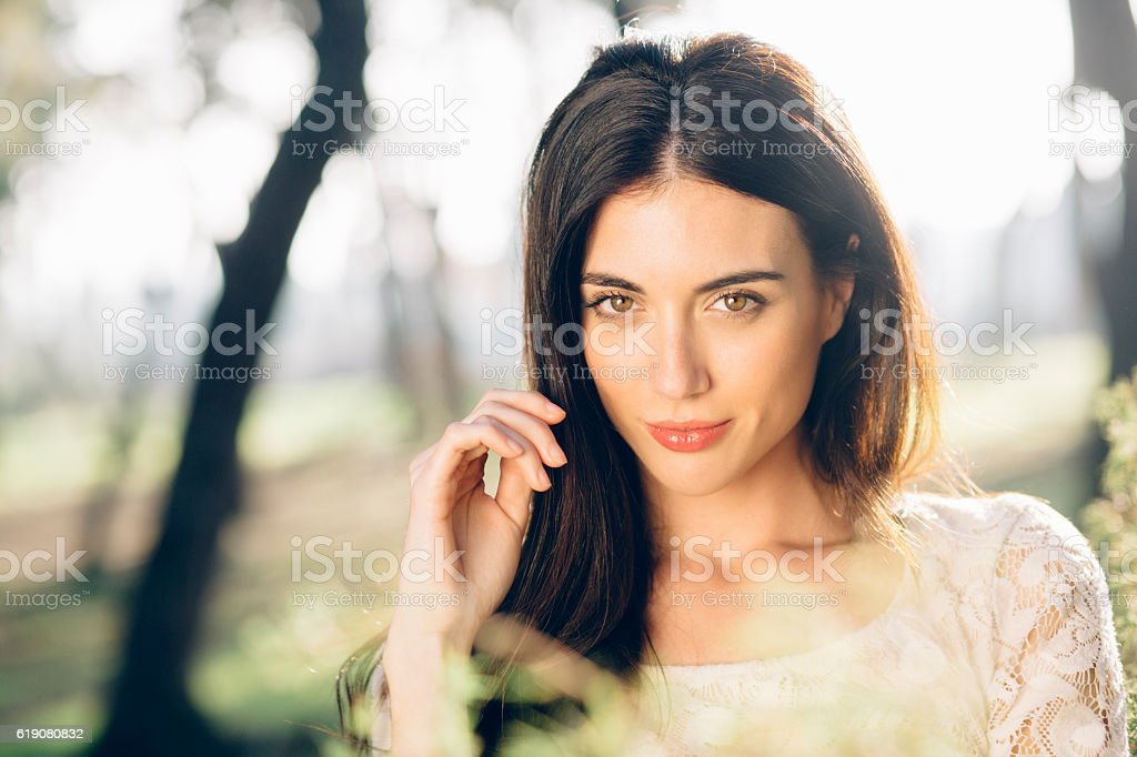 Beautiful woman in nature stock photo