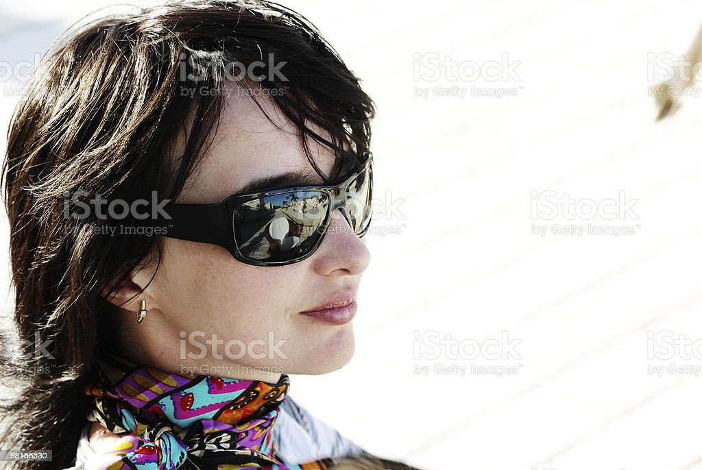 Beautiful woman in neckerchief and sunglasses royalty-free stock photo