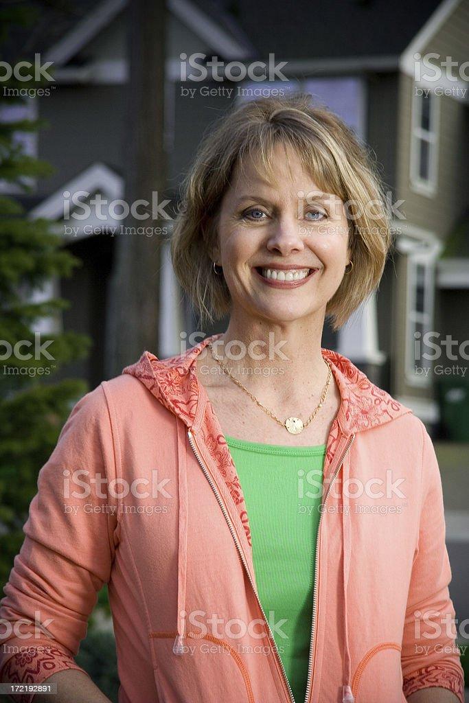 beautiful woman in neighborhood royalty-free stock photo