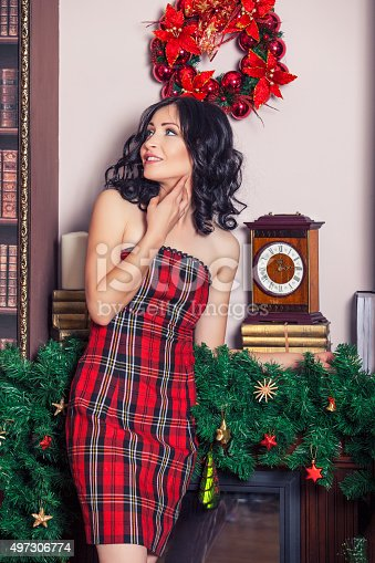 455111881 istock photo Beautiful woman in new year the interior is strong 497306774