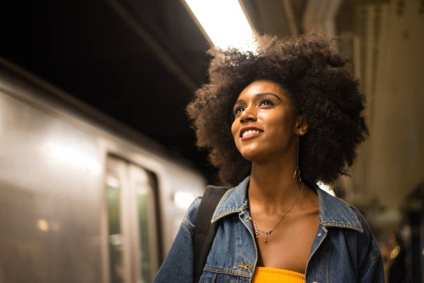 Beautiful woman in New York Happy african american woman smiling. Beautiful young female walking and having fun in New York city city life stock pictures, royalty-free photos & images