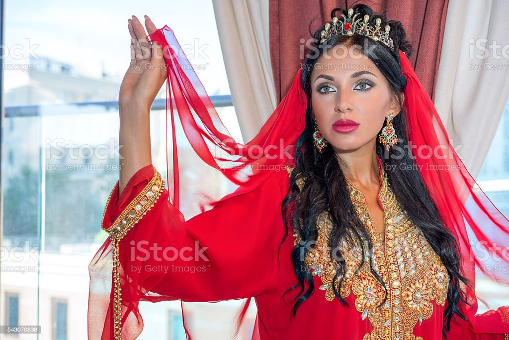 beautiful woman in oriental dress. stock photo