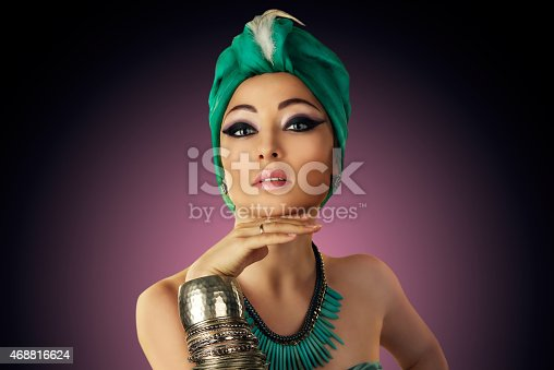 istock Beautiful woman in oriental style in turban 468816624