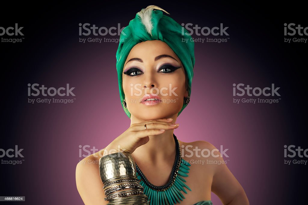 Beautiful woman in oriental style in turban stock photo