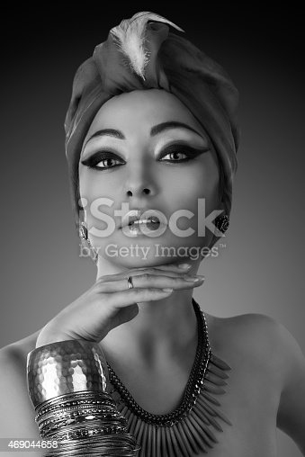 istock beautiful woman in oriental style in turban 469044658