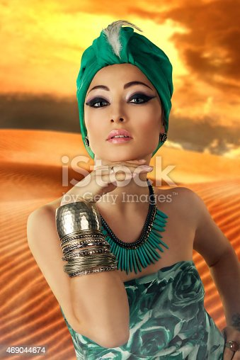 istock beautiful woman in oriental style in turban 469044674